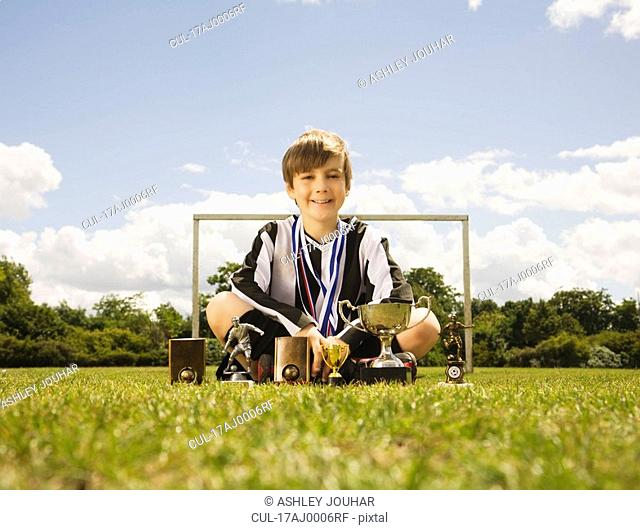 Boy footballer with Trophies