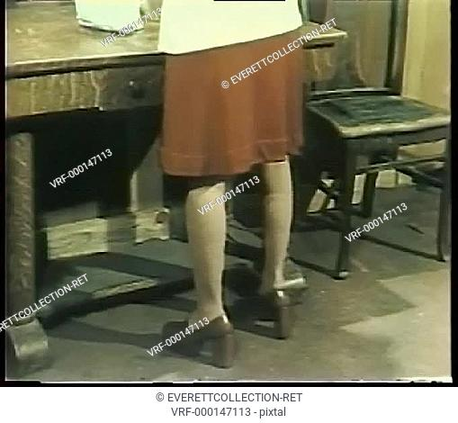 Rear view of lower half of woman wearing 1970s platform heels