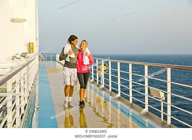Couple walking in the morning light on a shipdeck, cruise ship, Mediterranean Sea