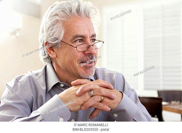 Hispanic businessman sitting in cafe