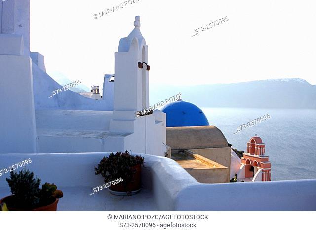 Blue domed chapels in Oia village, Santorini, Cyclades Islands, Greece