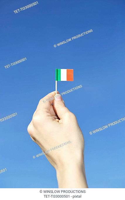 Woman holding Italian flag in hand