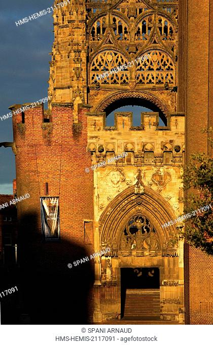 France, Tarn, Albi, listed as World Heritage by UNESCO, Sainte Cecile, partial view of the portal and the canopy of the catedral at sunrise