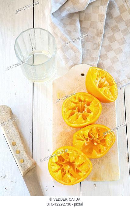 Pressed oranges on a cutting board