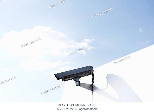 Surveillance camera on a building, cctv, vanilla sky