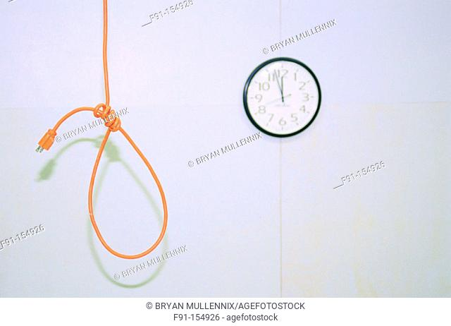 Noose made out of an electrical cord and clock