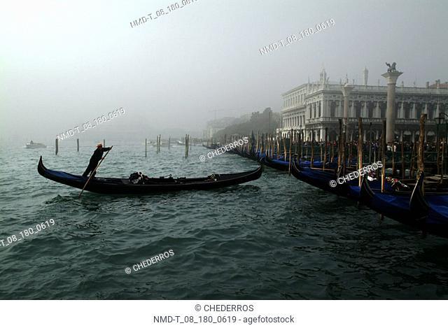 Silhouette of a gondola in a canal, Venice, Veneto, Italy