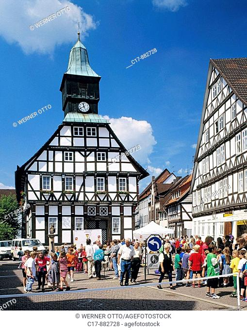 Germany, Uslar, Schwuelme, Ahle, Solling, Weserbergland, Lower Saxony, city hall with clock tower, half-timbered houses, pedestrian zone, people, children