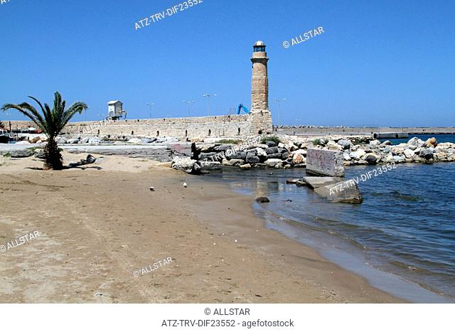 PALM TREES & LIGHTHOUSE ON PIER; RETHYMNON, CRETE, GREECE; 02/05/2014