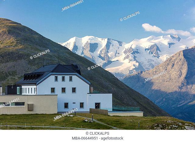 The hotel surrounded by high snowy peaks Muottas Muragl Samedan Canton of Graubünden Engadine Switzerland Europe