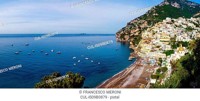 Cliff side buildings by sea, Positano, Amalfi Coast, Italy