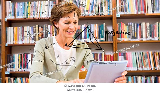 Digitally generated image of geometric structure with woman using digital tablet in library