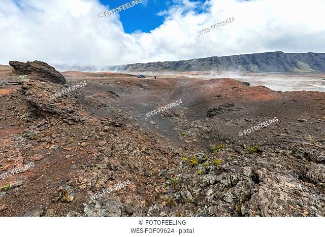 Reunion, Reunion National Park, Piton de la Fournaise, Route du volcan, Tourist in the Plaine des Sables