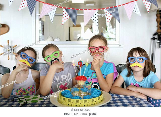 Children wearing disguises at birthday party