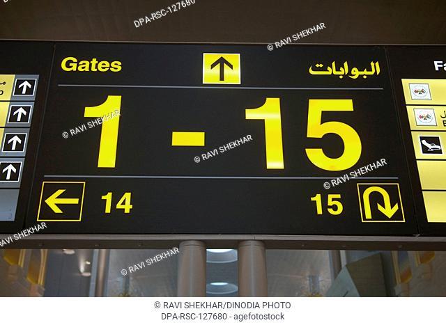 Black sign board 1-15 numbers gate of Dubai International Airport ; Dubai UAE United Arab Emirates