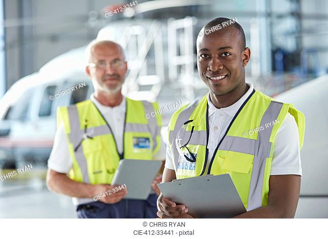 Portrait smiling air traffic control ground crew worker with clipboard
