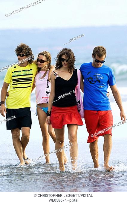 Two young couples on the beach