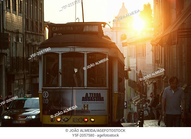 Lisbon's traditional yellow tram on the 28 line, passing at Calçada do Combro, the street that divides Bairro Alto and Bica neighborhoods