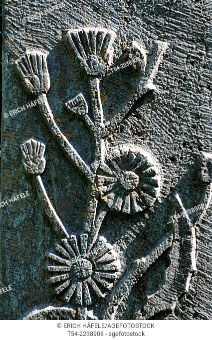 Stone carvings of flowers on a sculpture