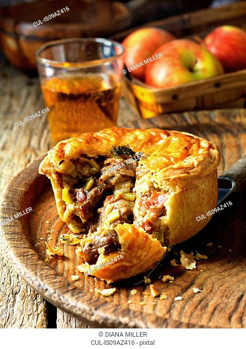 Pork, bacon, cider and buttered leek pie