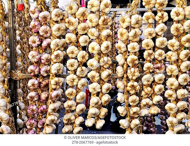 "Garlic strings photographed during the ""Feriona"" in Boñar. Leon Province, Spain. This fair is held once a year for the local people to buy commodities for the..."