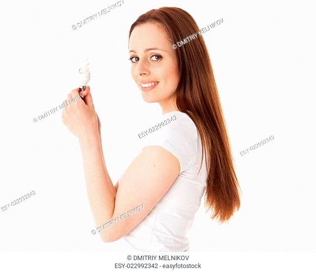 Young woman with energy efficient lightbulb