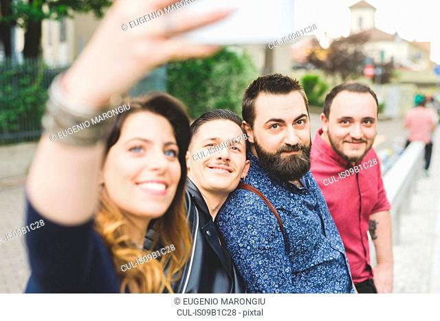 Group of friends taking selfie by roadside