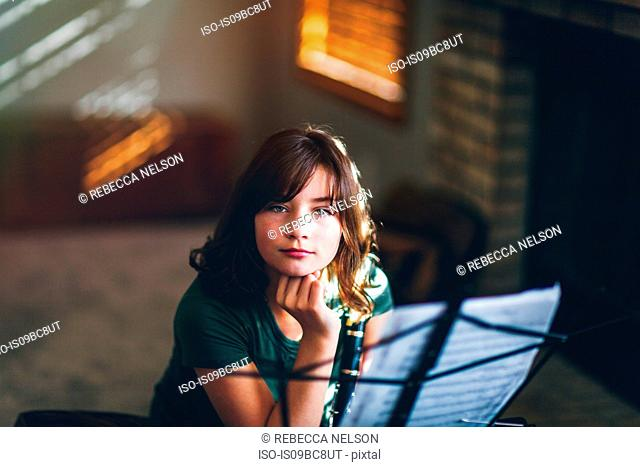 Girl daydreaming at clarinet practice