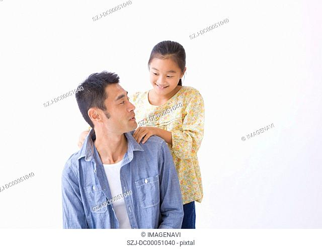 Daughter massaging father's shoulder