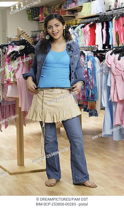 Hispanic teenaged girl shopping for clothing