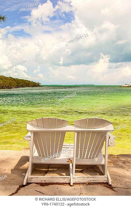 Two chairs looking out on the Abaco Sea in the tiny village of Hope Town, Elbow Cay Abacos, Bahamas