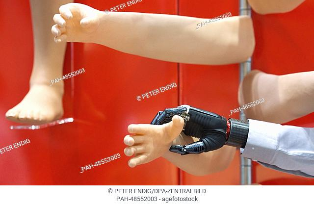 """A bionic hand reached for a arm covering at the booth of the Touch Bionics at the """"""""OTWorld"""""""" orthopedics and rehabilitation technology trade fair in Leipzig"""