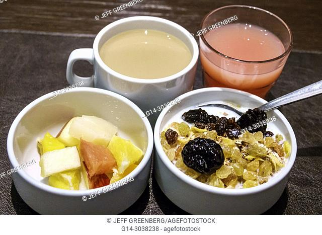 Argentina, Buenos Aires, Howard Johnson Hotel Boutique Recoleta, hotel, dining room, free breakfast, fruit, cereal, bowl, coffee cup, juice glass, Hispanic