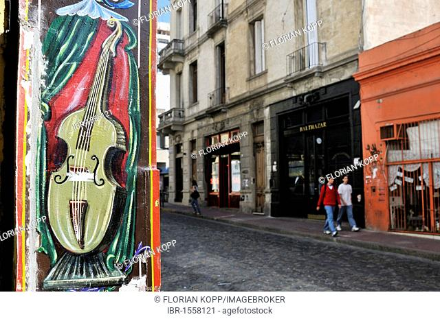Violin, colorful painting on a wall, Calle Defensa Street, historical district and tourist quarter of San Telmo, Buenos Aires, Argentina, South America