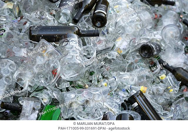 Beer mugs and bottles lying at the recycling depot of the Cannstatt Volksfest in Stuttgart, Germany, 05 October 2017. About four to five tons of garbage are...