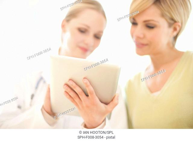 MODEL RELEASED. Doctor using a tablet computer