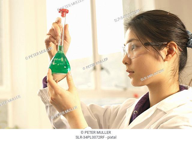 Scientist examining liquid in beaker