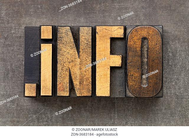 dot info - internet domain for information resources in vintage wooden letterpress printing blocks on a grunge metal sheet
