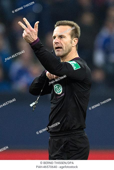 Referee Peter Gagelmann reacts during the soccer Bundesliga match between FC Schalke 04 and FSV Mainz 05 at the Veltins Arena in Gelsenkirchen, Germany