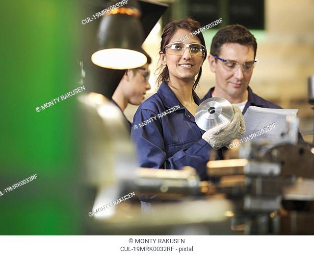 Female Apprentice In Workshop
