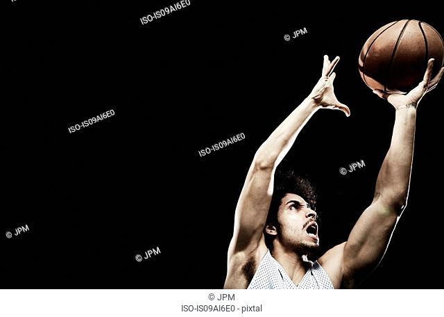 Basketball player catching basketball