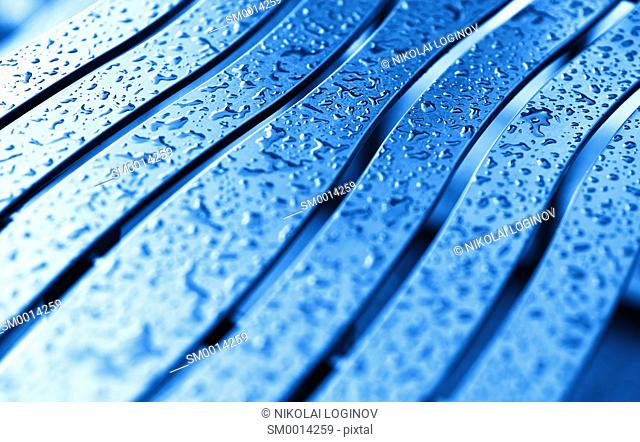 Diagonal blue bench with rain drops background hd