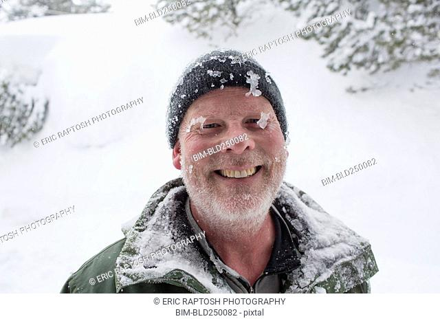 Caucasian man covered with ice and snow