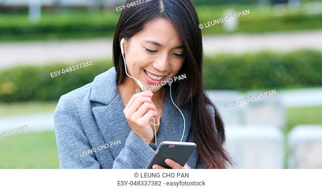 Woman talking on video call with mobile phone at outdoor