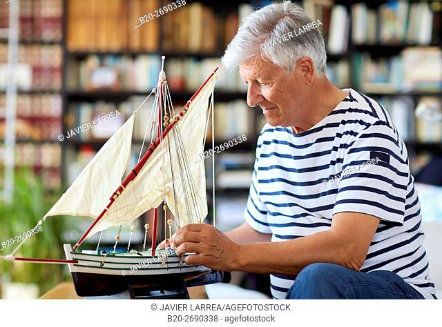 Senior man, 60-70, Building model sailboat, Whaleship, Getaria, Gipuzkoa, Basque Country, Spain, Europe