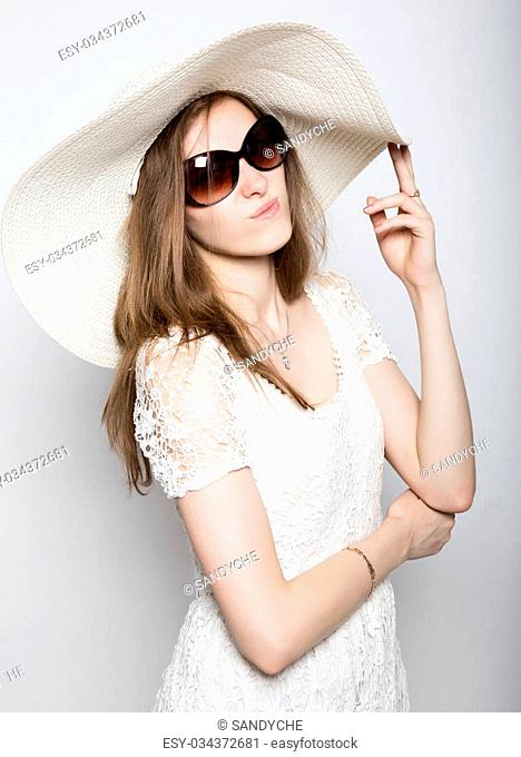 beautiful girl in broad-brimmed hat posing and expresses different emotions. headache, sadness, fatigue