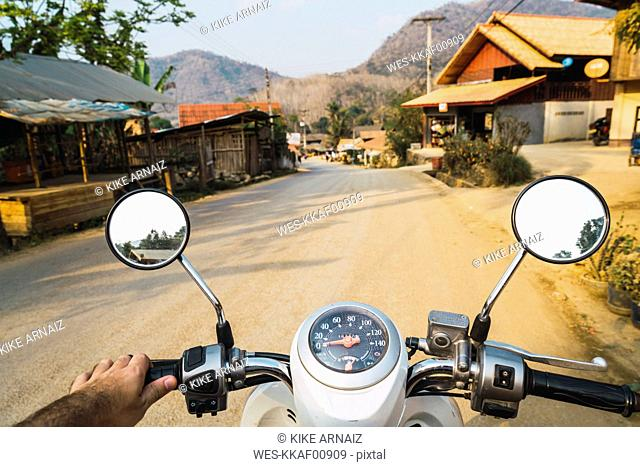 Laos, Motorbike ride in a village