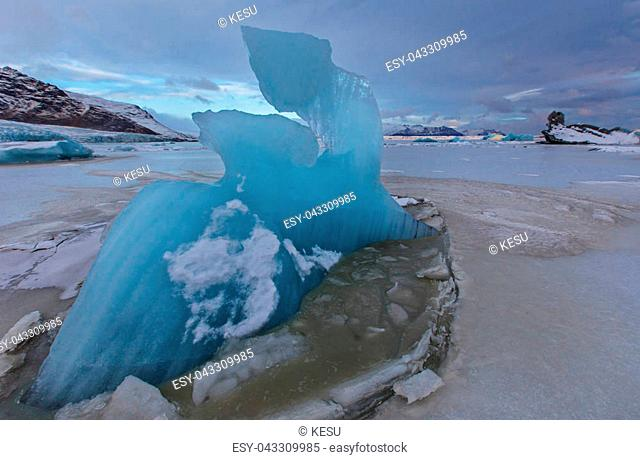 Famous Fjallsarlon glacier and lagoon with icebergs swimming on frozen water, southern Iceland, Europe