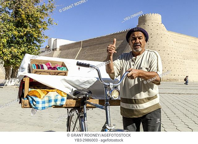 A Local Man Outside The Ark Fortress Selling Samsa (Meat Pies) From A Bicycle, Bukhara, Uzbekistan