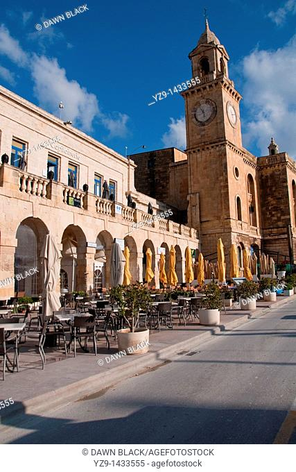 The clocktower of the old Naval Bakery, now the Maritime Museum in Vittoriosa, Malta  The arches now house restaurants